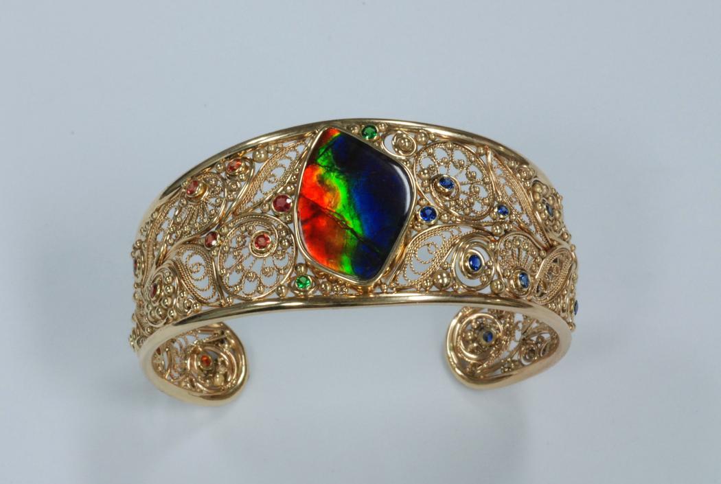 14k yellow Gold Ammolite with Blue Sapphires, Orange Sapphires and Tsavorite Garnet Bracelet